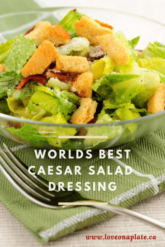 Caesar Salad with Bacon and Croutons in a glass bowl