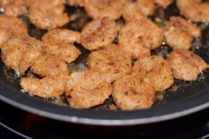 Fry breaded shrimp in pan