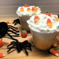 Candy Corn Parfaits, orange, white and yellow layers of pudding in a glass cup