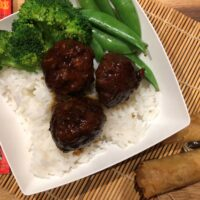 Honey Garlic Meatballs with white rice, broccoli and sugar snap peas