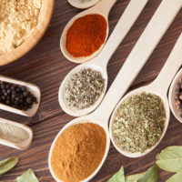Assorted Herbs and Spices on wooden spoons