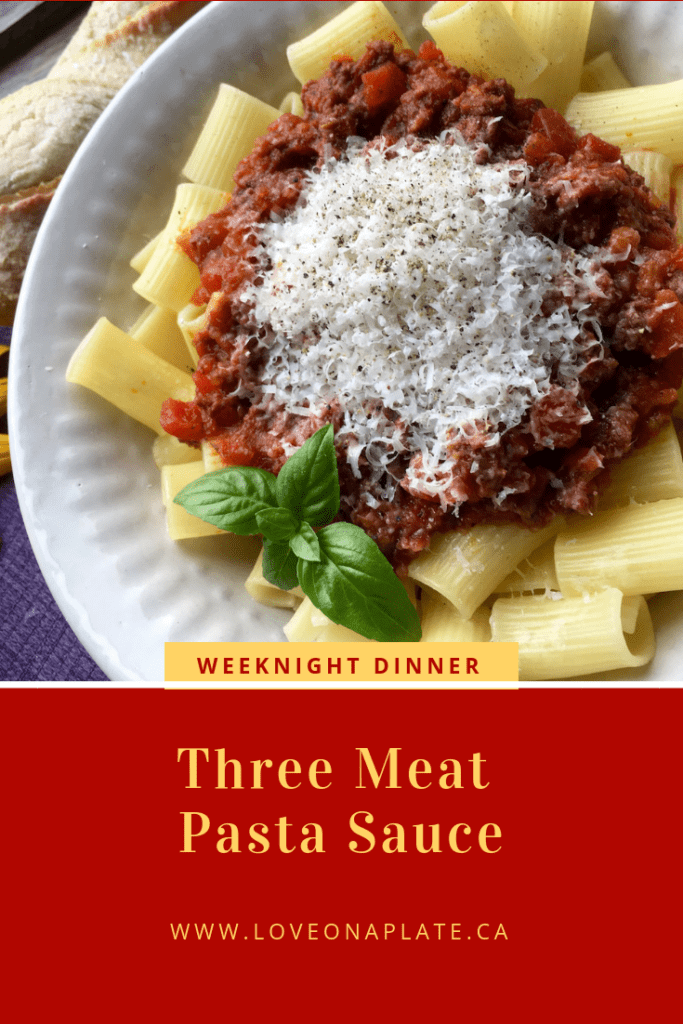 Three Meat Pasta Sauce served in a white bowl