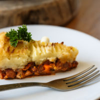 Baked Shepherds pie with minced meat on a plate