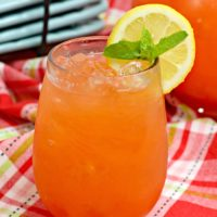 Fresh strawberry pineapple lemonade garnished with fresh mint and a lemon slice