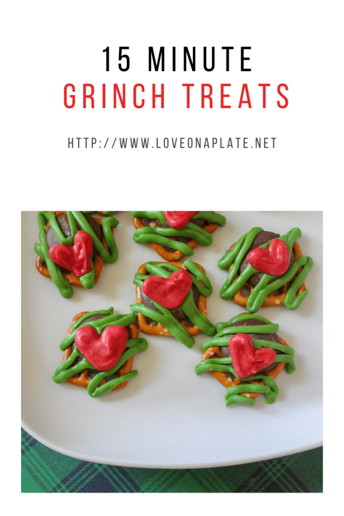 Square pretzels with chocolate pieces, green zig zag candy melt decoration and tiny red hearts